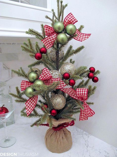 Tabletop Christmas Tree | Have you got a tiny space you'd like to decorate for the holidays? How about using a tabletop Christmas tree to accent your small spaces? -----> #designthusiasm #christmasdecorideas #christmasdecorations #holidaydecorideas #christmasdecorationideas #holidaydecoratingideas #holidaydecorations #holidaydecoronabudget #frenchcountrychristmas #glamchristmasdecor #tabletopchristmastree #farmhousechristmasdecor #DIYchristmasdecorations # #bathroomdiyideas