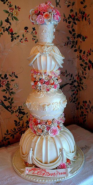 Tiered cake decorated with edible fondant and white chocolate decoration. Gumpaste flowers. A real show stopper.