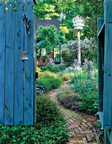 charming blue garden gate with bell