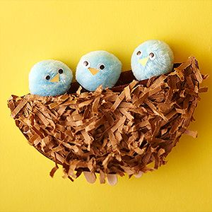 Paper Plate Nest: Cut a paper plate in half and staple the rims together (leaving the top of the ?nest? open). After your kids paint it brown, help them glue shredded brown paper onto the front to add texture. Create the birds by gluing three blue pom-poms to the ends of Popsicle sticks. Add googly eyes and orange paper beaks for a little personality. Have your kids slide the ends of the Popsicle sticks between the plates so the baby birds can rest inside their new nest -- and even pop up whe...