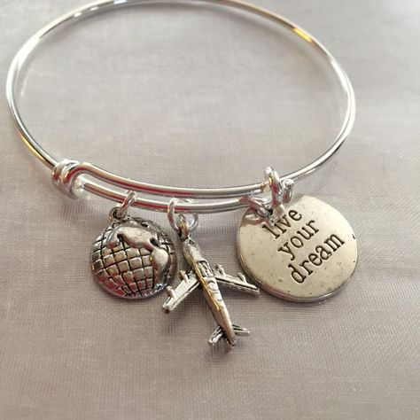 Travel bracelet. Bracelet with airplane world and stamped live your dream- Alex and Ani inspired. Bracelet is silver plated over brass. Bracelet can