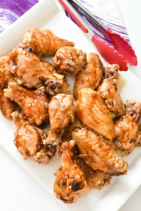Oven-Baked Buffalo Chicken Wings. Get the crispiest buffalo chicken wings without deep frying! This baked recipe is pretty easy, & will produce juicy chicken wings with a crispy skin. #buffalochicken #chickenwings #buffalowings #bakedchicken