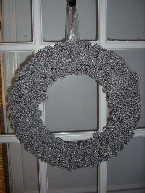 Here's an idea for a lovely low-cost #wreath!    Items Needed:          120 Sweet Gum Balls  Styrofoam or Straw Wreath  Can of Silver Spray Paint  Glue gun & glue  Toothpicks  Ribbon for Hanging  Floral Picks to Attach Ribbon  Spray Glitter or Spray Adhesive & Loose Glitter    Purchase a styrofoam or straw wreath and collect about 120 sweet gum balls found under the trees (and if still hanging, just pull off the tree)     Find directions here: http://www.itsallabouthome.com/sweet-gum-wreath