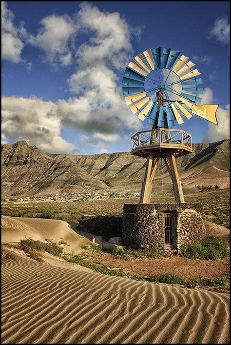 "Windmill near the ""Caleta de Famara"" beach in Lanzarote, Canary Islands, Spain."