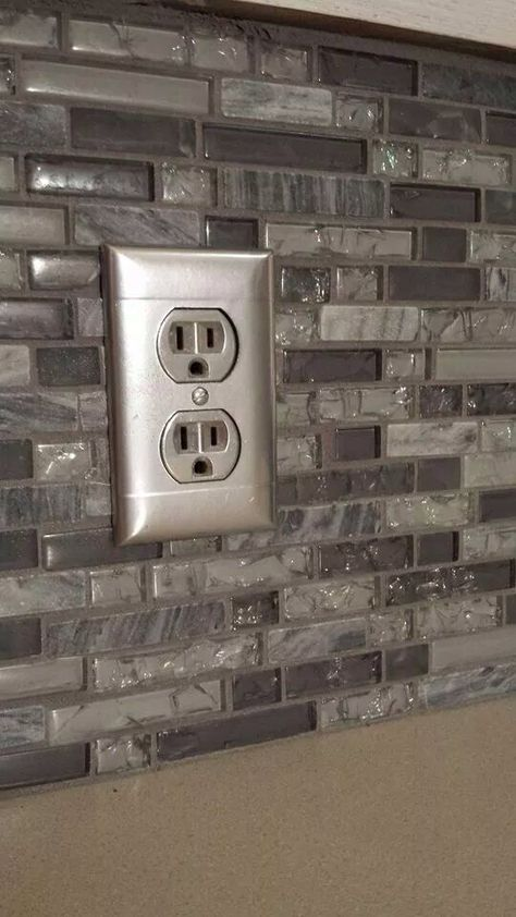 Customer do it yourself project. She took metallic spray paint and covered her outlets with a matching tone to her mosaic tiles. End result is fabulous! Mosaics available at Color Tile Carpet in Salem, Oregon. WWW.COLORTILESALEM.COM