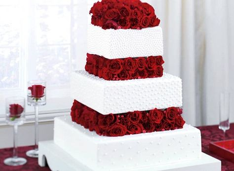 This is JUST like our wedding cake, only we didn't have the dots on the side, just filigree and an extra tier.