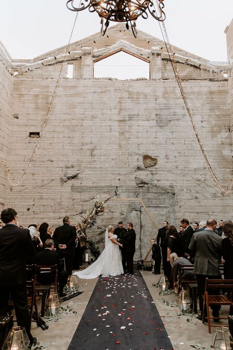This industrial wedding venue in downtown Phoenix has been steadily gaining momentum since its grand opening, and we can certainly see why! The Icehouse sets the stage for moody wedding ceremonies perfecty with its exposed brick and open air structure. McKenna and Nick knew this was the only spot for them, and the result is a black   burgundy wedding with a dramatic twist on romantic details from start to finish. Head over to Ruffled now to see the full gallery AND the epic denim bridal jacket M