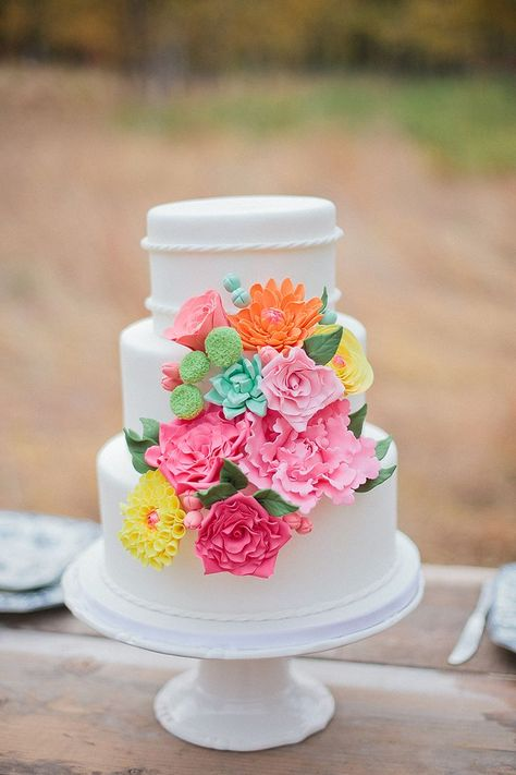 Colorful Flowers on Tiered White Cake