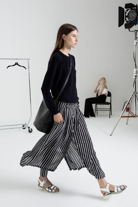 metallic sandals, crazy pant/skirt situation, and casual sweater
