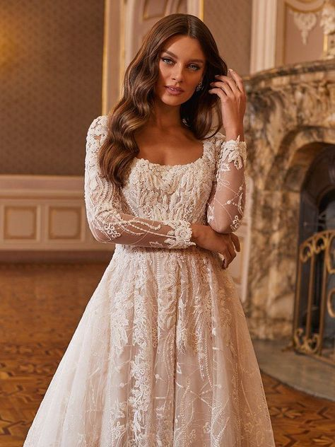 For our goddess queens out there, Val Stefani Style Floria is beautiful as can be. This long sleeve bridal ball gown features dreamy embroidered lace appliques with sequins and crystals, pearls, and glass beading details that will leave you looking dreamy as can be. With the square neckline, this gown allows for you to show off your best assets in the most romantic way. #weddinggowns #weddingdresses #weddingdressideas #longsleeveweddingdress