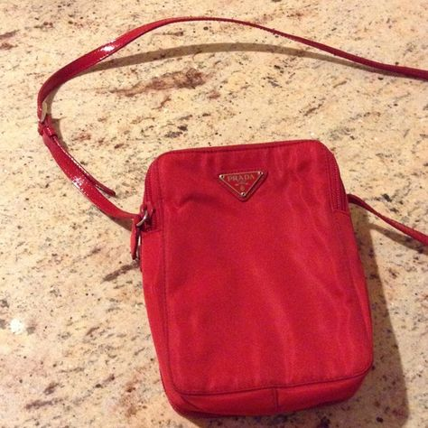 Prada crossbody bag Perfect for traveling or busy hands. Lots of compartments for cards, cell phones, cameras, passports, etc. Dimensions are 5 by 7 and 2 inches deep. Can fit iPhone six plus and galaxies. Great condition. Prada Bags