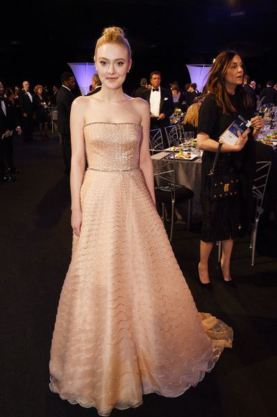 Actor Dakota Fanning attends the 24th Annual Screen Actors Guild Awards.