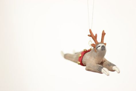 This sloth wearing reindeer antler and a sleigh hitch with bells is one of the cutest Christmas tree ornaments ever!
