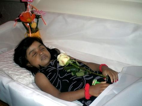 Postmortem young lady, holding a yellow rose (symbolizes peace)