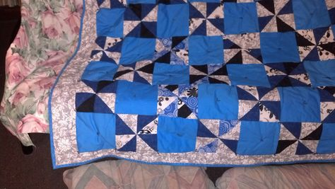 most of the quilt laying across the fouton