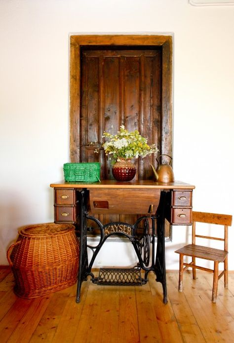 The old sewing machine from an antique shop was turned into writing table. via designtripper.com