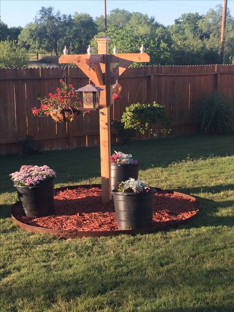 Pergola pole for deck corners. Can incorporate bird feeder and hanging pots