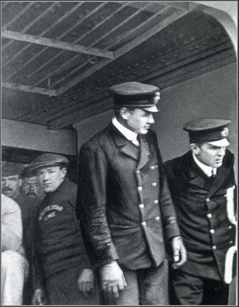 """""""Only known photograph aboard Titanic and also last known photograph. Pictured alongside Lightoller, as they prepare to close the gangway before depature from Queenstown, Ireland on April 11th, 1912. It is also the last known photograph of a Titanic officer on duty."""""""