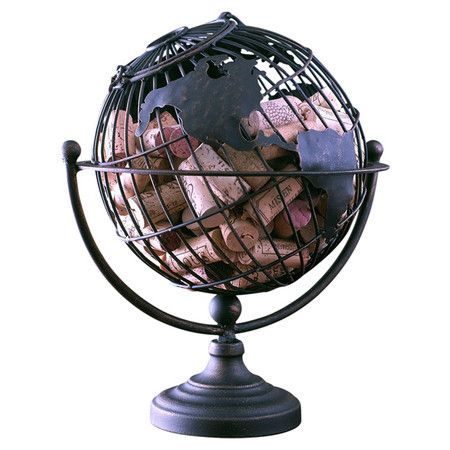 The perfect gift for the wine lover in your life, this handcrafted metal cork holder showcases a globe silhouette for a touch of stately style. ...