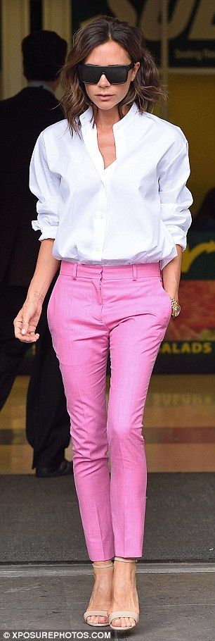 Pretty in pink: Victoria has long discussed the fashion benefits of a white button down shirt, teaming them on Monday with bright trousers