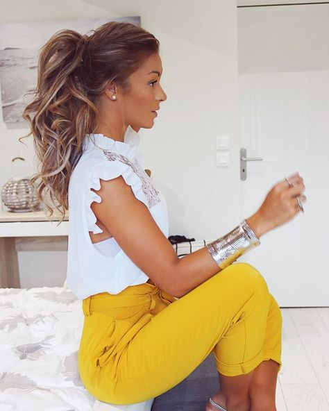 High bright colored pants with white frilly top - this is the prettiest ponytail ever. High bright c