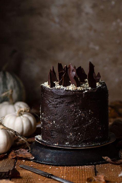Chocolate Bourbon Pumpkin Cake | #halloweencake #pumpkincake #chocolatebuttercream #pumpkindessert #datedessert #chocolatecake #falldessert #fallrecipe #halloweenrecipe #halloweendessert #layercake #pumpkin #chocolate | twocupsflour.com