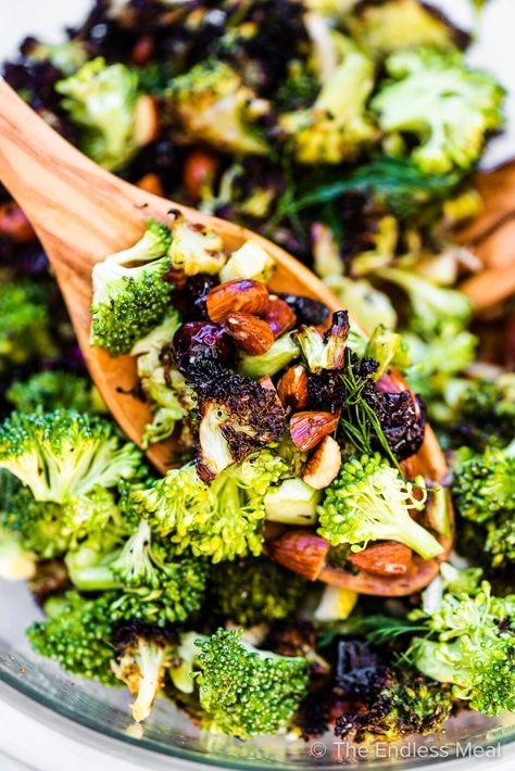 SAVE FOR LATER! This Roasted Broccoli Salad has both roasted and raw broccoli, toasted almonds, cranberries and tiny pieces of tart lemon. It's paleo, vegan and delicious! It will be a hit at all of your summer parties. #theendlessmeal #roastedbrocooli #broccolirecipes #summersidedish #BBQ #glutenfree #paleo #vegan #vegetarian #healthysidedish #healthyrecipes #summerrecipes #broccoli #broccolisalad #salad #saladrecipes #broccolirecipes