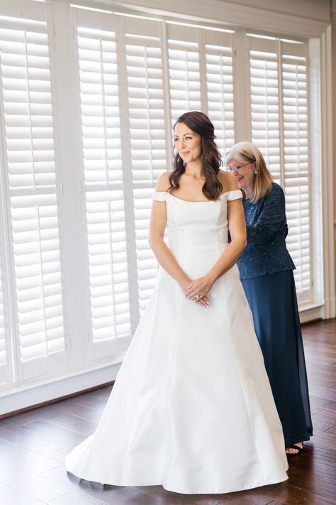 See more of this beautiful black tie wedding day on the blog. Today we've got real White Room Birmingham bride Callie on the blog. She's sharing her experience as a covid bride planning her wedding during the pandemic. We especially love her in this gorgeous Anne Barge wedding dress with the off the shoulder sleeves. #blacktie #weddinginspiration #covidwedding #covidbride #bride #weddingdress