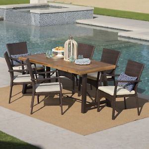 Landon Outdoor 7 Piece Dining Set With Teak Finished Wood Table And Brown Chairs Wicker Dining Set Wicker Dining Chairs Outdoor Dining Set