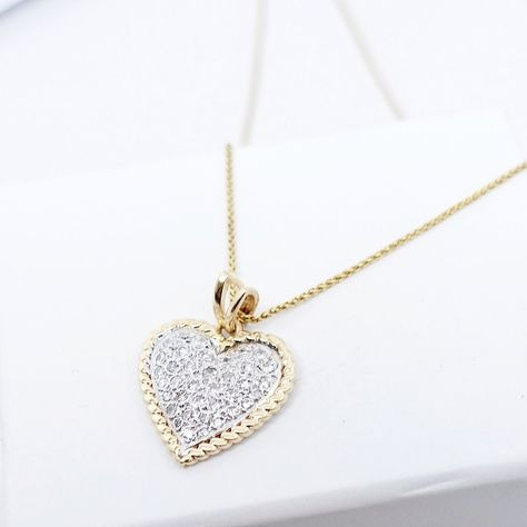 Material: 14K Yellow Gold Pendant Width: 20mm; Diamonds: 0.70cts Quality: H-I color, SI-I1 clarity Chain: 16 inches