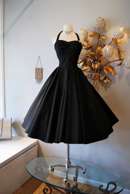 The ultimate little black dress! black taffeta with full circle skirt and halter neck. Simple yet spellbinding! At Xtabay - Vintage clothing store in Portland, Oregon.