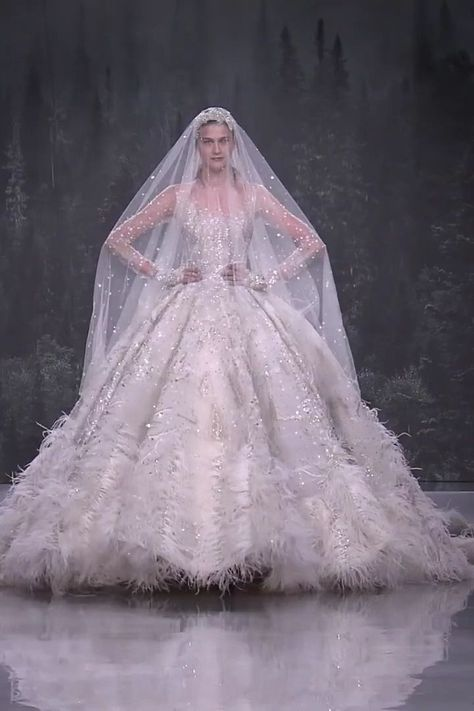 Uniq Embroidered Wedding Dress / Bridal Ball Gown with Boat Neckline, Long Sleeves, a Veil and Cathedral Train. Fall Winter 2018/2019 Haute Couture Collection. Fashion Runway by Ziad Nakad   -  #hautecouture #hautecouture2018 #hautecoutureBijoux #hautecoutureChristianLacroix