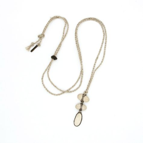 A rare three drop pendant made white Japanese river pebbles, cross wrapped with silver and crafted in LoU's unique style. Hung from a braided natural cord; its length is adjusted by a carved wooden bead. This beautiful three drop pendant is one of the few remaining in the LoU Zeldis collection. Dimensions in inches: 2.25'' x .75'' Cord length in inches: 44'' LZCPS-030