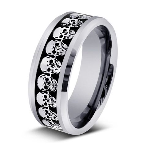 skull design mens wedding ring; I know its kinda odd, but kinda cool too.