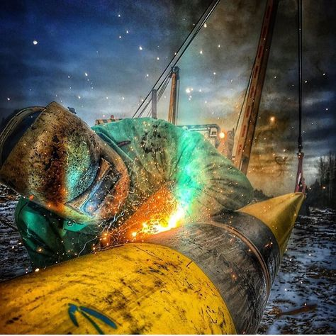 pipeline welding at night time