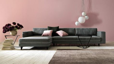 Modern sectional sofa with pretty armchair and nice wooden tables in ...