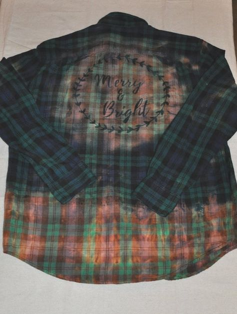 Merry and Bright Faded Flannel Shirt Make a statement during this Christmas season with this cute & comfy flannel Christmas shirt! SIZING: This handmade flannel shirt is made to order from a unisex flannel shirt (MENS SIZES) & comes with bottom portion of the shirt faded/distressed along with a