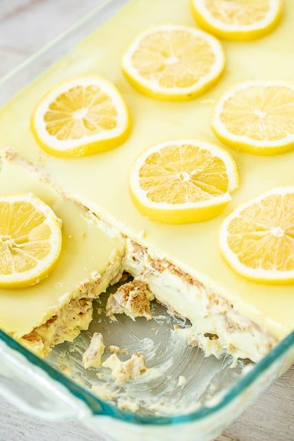 No-Bake Lemon Eclair Cake Recipe - lemon pudding, cool whip and graham crackers layered and topped with lemon frosting. It gets better the longer it sits in the fridge - it is just SO hard to wait to eat it. SOOO good. People go nuts over this easy dessert recipe! Great for parties and potlucks. There are NEVER any leftovers! #nobakedessert #dessert #lemon #iceboxcake