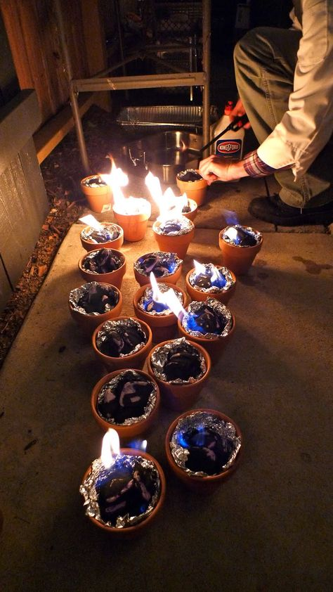 I would never think of this! Light charcoal in terracotta pots lined with foil for tabletop smores.  Fun outdoor summer party idea.