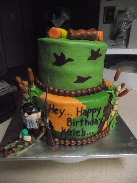Duck Dynasty My grandson's birthday cake. Iced with buttercream. Uncle Si, duck call and shotgun shells on top of cake are made from.