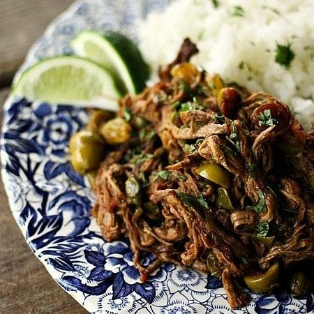 Ropa Vieja Thin Shreds Of Flank Steak Braised In A Rich Tomato Vegetable Sauce With Olives Capers Prepare In An Instant Pot Recipes Beef Recipes Pot Recipes
