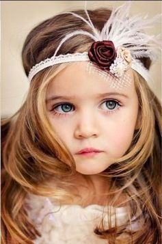 38 Super Cute Little Girl Hairstyles for Wedding 38 Super Cute Little Girl Hairstyles for Wedding Little Flower Girl with Feather Crown