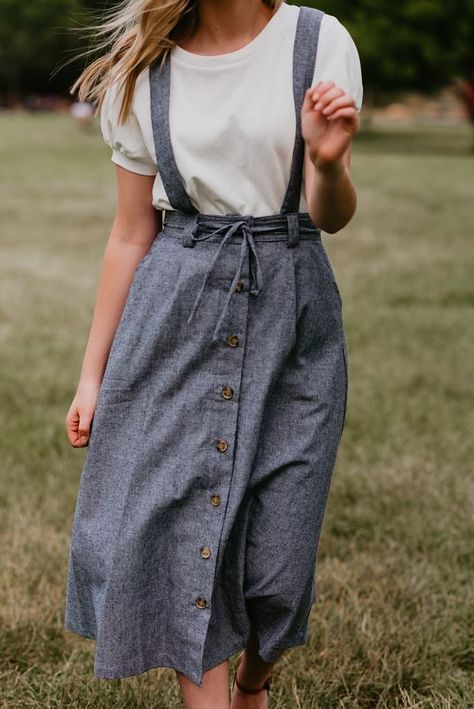 For daytime outings or nights out, you'll love the sweet and sassy style of the Darby Button Down Overall Skirt. Layer a dainty blouse beneath this denim skirt for a simply chic look.