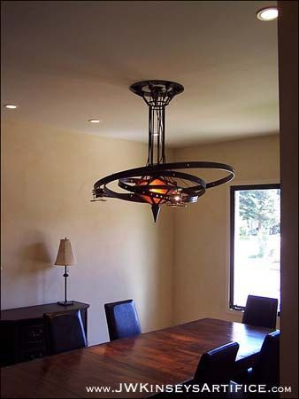 the Chandrian Orrery Chandelier: a hand-made steampunk styled lamp
