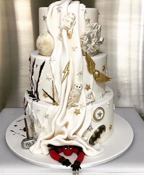 I need this cake in my life - but with Harry Potter stuff, and Daenerys, and Harley, and Bella and Edward, and the great gatsby somehow, and jack and sally, and of course Deadpool - someone I know needs to make this happen lol!