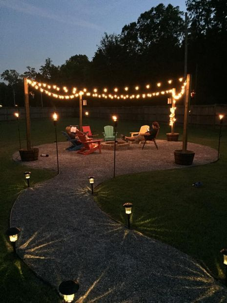 DIY Outdoor fire pit with sweet ambiance effect!  This guy uses limestone for the walkway and seating area. I think for my house I would use pavers.  Pavers would be more work though....