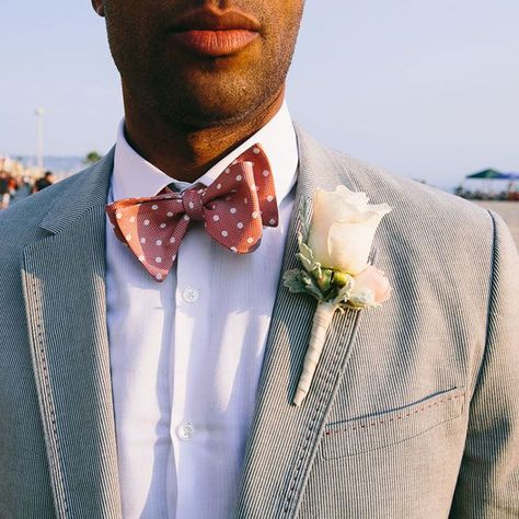 Complete your groom's coastal wedding look with a soft classic boutonniere comprised of off-white roses. This look is also great for a summer beach wedding. Click through for more boutonniere ideas! #boutonniere #roseboutonniere #coastalwedding #nauticalwedding #beachwedding