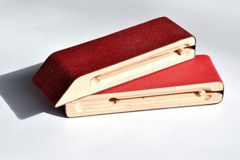 Handheld sanding blocks are a must for every woodworker. These can be made quickly from scrap 2x4s and spare dowels.