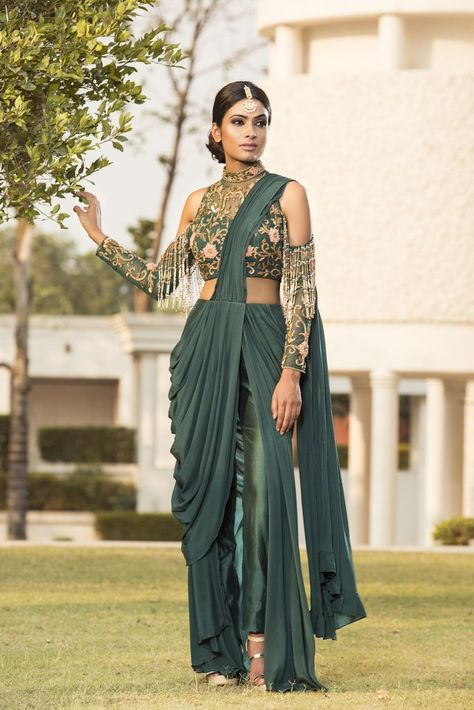 Bottle green hand embroidered tasseled blouse with drape bottom set. Fabric: Crepe;Chanderi Care: Dry Clean Only