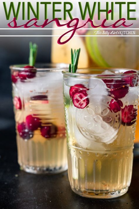 Winter white wine sangria is a refreshing mixed drink to serve during the holidays! This white wine sangria is light, refreshing and effervescent, with flavors of vanilla, apples, and cranberries. PIN IT NOW TO SAVE Winter Sangria, Cranberry Sangria, Holiday Sangria, White Wine Sangria, Winter Drinks, White Christmas Sangria Recipe, White Wine Apple Sangria Recipe, White Sangria Recipes, Champagne Sangria